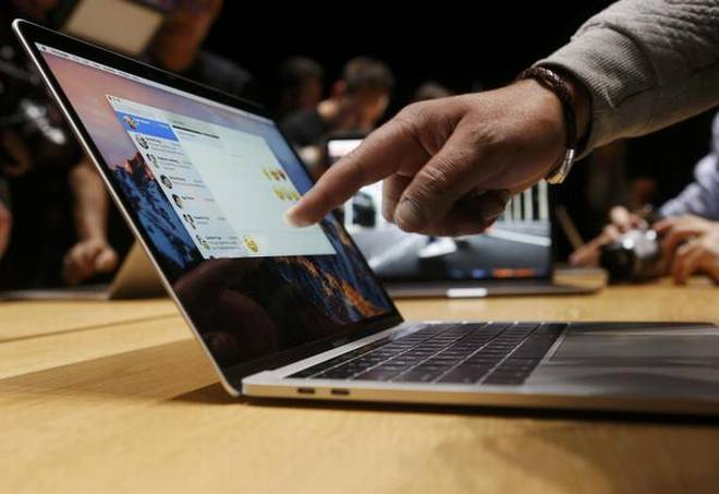 You can't carry a certain Macbook pro devices on flights; here's why
